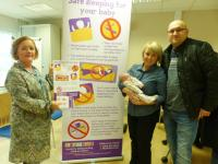 Jackie Taylor, Health Visitor, with Karolina, Marek and baby Amelia
